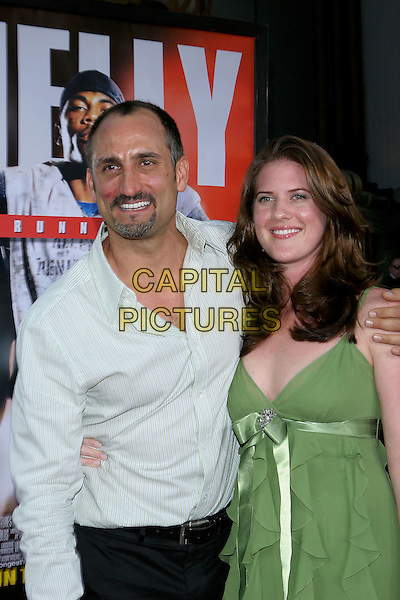 """NICK TURTURRO & GUEST.World Premiere of """"The Longest Yard"""" held at Grauman's Chinese Theatre..May 19th, 2005.Photo Credit: Jacqui Wong/AdMedia.half length hand on shoulder green ribbon dress.www.capitalpictures.com.sales@capitalpictures.com.© Capital Pictures."""