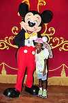 LAKE BUENA VISTA, FL - OCTOBER 01: Young actress / model Jayden poses with Mickey Mouse while visiting the Cinderella's Castle in the Magic Kingdom during Walt Disney World Resort's 40th Anniversary Celebration at Walt Disney World Resort on October 01, 2011 in Lake Buena Vista, Florida. Walt Disney World opened on October 01, 1971. (Photo by Johnny Louis/jlnphotography.com)