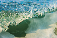 The close up of a breaking wave of the Pacific Ocean at Anna Maria Island in Southern Florida.
