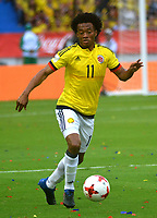BARRANQUILLA - COLOMBIA -08-10-2015: Juan G Cuadrado jugador de Colombia en acción durante partido entre Colombia y Bolivia por la fecha 13 de la clasificatoria a la Copa Mundial de la FIFA Rusia 2018 jugado en el estadio Metropolitano Roberto Melendez en Barranquilla. / Juan G Cuadrado player of Colombia in action during the match between Colombia and Bolivia for the date 13 of the qualifier to FIFA World Cup Russia 2018 played at Metropolitan stadium Roberto Melendez in Barranquilla. Photo: VizzorImage / Alfonso Cervantes / Cont