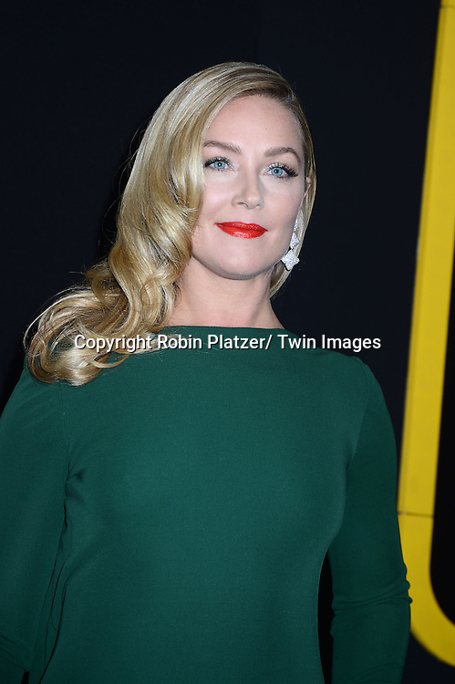 "Elisabeth Rohm in green Randi Rahm dress arrives at the World Premiere of ""American Hustle"" on December 8, 2013 at The Ziegfeld Theatre in New York City."