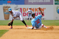 Aaron Hicks (32) of the New Britain Rock Cats slides into second base in front of shortstop Edgar Duran during a game against the Reading Fightin Phils at New Britain Stadium on June 22, 2014 in New Britain, Connecticut.  New Britain defeated Reading 5-3.  (Gregory Vasil/Four Seam Images)