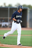 Gareth Morgan #18 of the AZL Mariners runs to first base during a game against the AZL Giants at Peoria Sports Complex on July 10, 2014 in Peoria, Arizona. (Larry Goren/Four Seam Images)