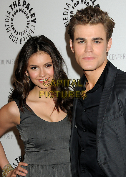 "NINA DOBREV & PAUL WESLEY .27th Annual Paley Fest: William S. Paley Television Festival ""The Vampire Diaries"" held at The Saban Theatre, Beverly Hills, California, USA, .6th March 2010.half length dress peplum layered layer hand on hip sleeveless grey gray shirt jacket black .CAP/ADM/BP.©Byron Purvis/AdMedia/Capital Pictures."