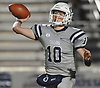 Tommy Heuer #10, Oceanside quarterback, throws a pass during the Nassau County Conference I varsity football final against Freeport at Hofstra University on Saturday, Nov. 18, 2017. Oceanside won by a score of 17-0.