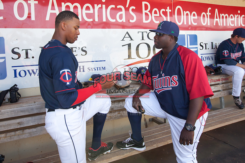 Cedar Rapids Kernels outfielder Byron Buxton #7 talks with hitting coach Tommy Watkins #8 during a game against the Lansing Lugnuts at Veterans Memorial Stadium on April 30, 2013 in Cedar Rapids, Iowa. (Brace Hemmelgarn/Four Seam Images)