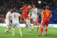 Cardiff City Stadium, Friday 11th Oct 2013. James Collins of Wales challenges Nikolce Noveski of Macedonia from a corner kick during the Wales v Macedonia FIFA World Cup 2014 Qualifier match at Cardiff City Stadium, Cardiff, Friday 11th Oct 2014. All images are the copyright of Jeff Thomas Photography-07837 386244-www.jaypics.photoshelter.com