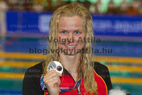 Britta Steffen of Germany celebrates her victory in the Women's 50m Freestyle final of the 31th European Swimming Championships in Debrecen, Hungary on May 27, 2012. ATTILA VOLGYI