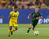 GRENOBLE, FRANCE - JUNE 18: Kayla Mccoy #22 of the Jamaican National Team dribbles at midfield during a game between Jamaica and Australia at Stade des Alpes on June 18, 2019 in Grenoble, France.