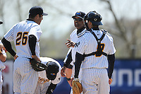Trenton Thunder manager Tony Franklin (18) talks with infielder Rob Segedin (26) and catcher Kyle Higashioka (8) during game against the Akron Aeros at ARM & HAMMER Park on April 17, 2013 in Trenton, New Jersey.  Akron defeated Trenton 10-6.  Tomasso DeRosa/Four Seam Images