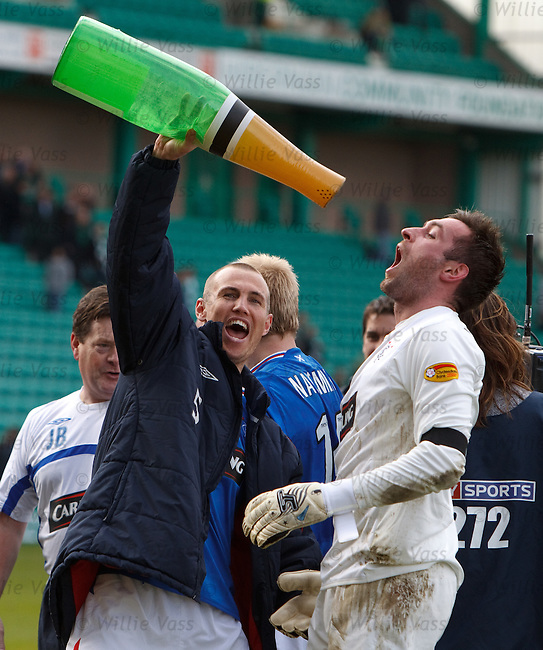 Kenny Miller and Allan McGregor celebrate winning the SPL championship with a large bottle of bubbly