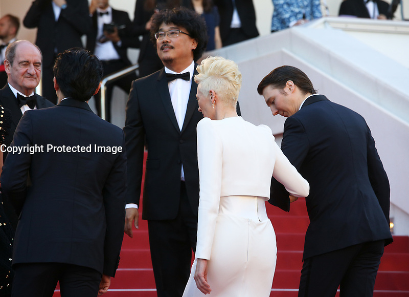 DIRECTOR BONG JOON-HO, TILDA SWINTON AND PAUL DANO - RED CARPET OF THE FILM 'OKJA' AT THE 70TH FESTIVAL OF CANNES 2017