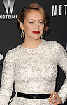 Alyssa Milano arriving at The Weinstein Company and Netflix 2014 Golden Globes After Party, held at the old Trader Vic's in The Beverly Hilton Hotel on January 12, 2014