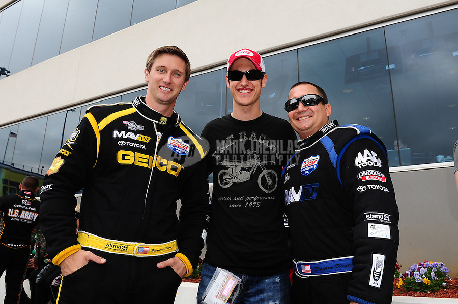 Apr. 15, 2012; Concord, NC, USA: NHRA top fuel dragster drivers Morgan Lucas (left) and Brandon Bernstein (right) with NASCAR driver Joey Logano during the Four Wide Nationals at zMax Dragway. Mandatory Credit: Mark J. Rebilas-