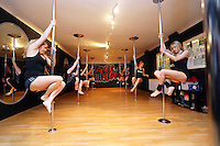 Pictured: Pole dancers during their world record attempt. Saturday 22 February 2014<br />