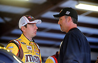 Oct. 30, 2009; Talladega, AL, USA; NASCAR Sprint Cup Series driver Kyle Busch (left) talks with crew chief Steve Addington during practice for the Amp Energy 500 at the Talladega Superspeedway. Mandatory Credit: Mark J. Rebilas-