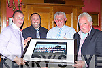Pat O'Shea (second from left) manager presents a picture of the 2012 Novice Champions to l-r: Martin Hewitt Captain, Pat O'Sullivan Chairman and Connie Kerins PRO at the Scartaglen GAA social in the River Island Hotel on Saturday night