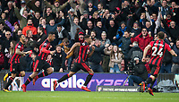 Winning goalscorer is chased by teammates Lys Mousset & Callum Wilson during the Premier League match between Bournemouth and Arsenal at the Goldsands Stadium, Bournemouth, England on 14 January 2018. Photo by Andy Rowland.