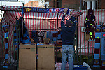 West Ham United 2 Crystal Palace 2, 02/04/2016. Boleyn Ground, Premier League. A souvenir seller hanging up a scarf at a stall outside the Boleyn Ground before West Ham United hosted Crystal Palace in a Barclays Premier League match. The Boleyn Ground at Upton Park was the club's home ground from 1904 until the end of the 2015-16 season when they moved into the Olympic Stadium, built for the 2012 London games, at nearby Stratford. The match ended in a 2-2 draw, watched by a near-capacity crowd of 34,857. Photo by Colin McPherson.