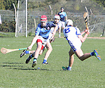 1310/2015   Action from Sixmilebridge where Sr Flannen's College took on Castletroy College in the Harty Cup.  Our photograph shows Brian Garry, Castletroy tries to slip the ball passed an incoming Ross Hayes, Flannans.<br /> Photograph Liam Burke/Press 22