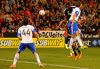 WASHINGTON, D.C - May 17 2014: Eddie Johnson  heads in his first goal, D.C. United vs the Montreal Impact in an MLS match at RFK Stadium, in Washington D.C. The game ended in a 1-1 tie.