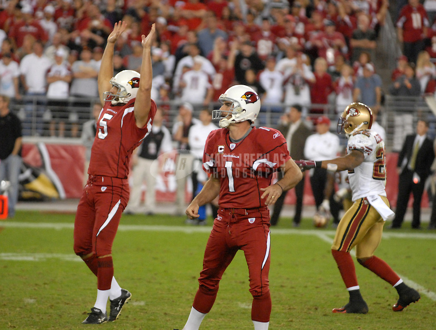 Nov. 25, 2007; Glendale, AZ, USA; Arizona Cardinals kicker Neil Rackers (1) looks on as holder Mike Barr (5) celebrates what he thought was a game winning field goal in overtime against the San Francisco 49ers at University of Phoenix Stadium. Racker missed the kick. The 49ers defeated the Cardinals 37-31 in overtime. Mandatory Credit: Mark J. Rebilas-US PRESSWIRE