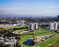 aerial photograph the Interlomas Golf Course in Mexico City with Iztaccihuatl and Popcatepetl volcanoes in the background