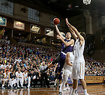 SIOUX FALLS, SD - FEBRUARY 27:  Jordan Stotts #44 from the University of Sioux Falls takes the ball to the basket past a pair of defenders including Casey Schilling #32 from Augustana during their NSIC Tournament game Saturday night at the Pentagon in Sioux Falls. (Photo by Dave Eggen/Inertia)