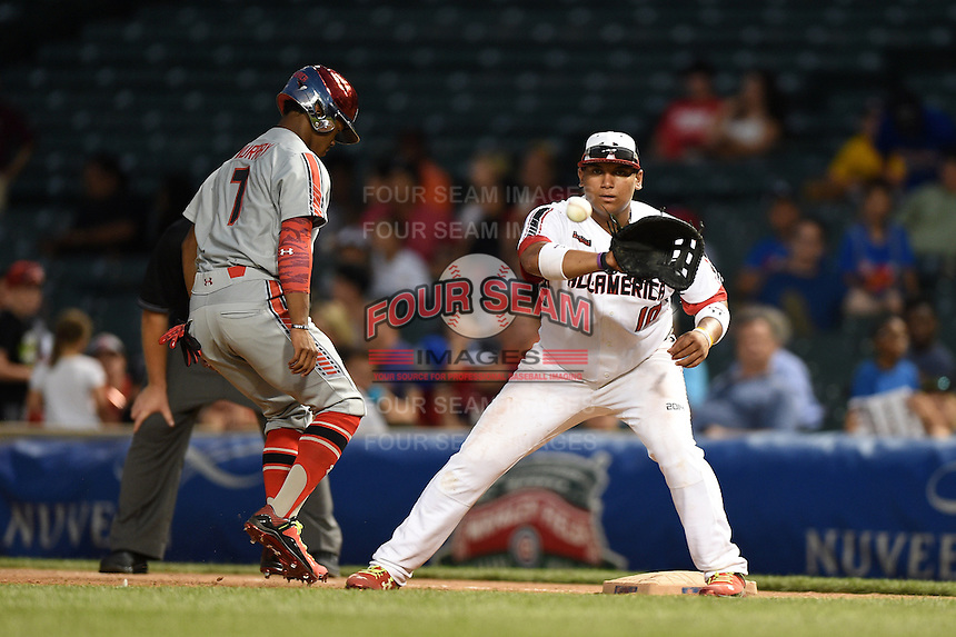 Josh Naylor (10) of St. Joan of Arc High School in Mississauga, Ontario, Canada takes a throw as Kyler Murray (7) gets back to the bag during the Under Armour All-American Game on August 16, 2014 at Wrigley Field in Chicago, Illinois.  (Mike Janes/Four Seam Images)