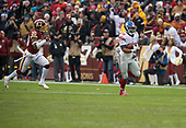 New York Giants running back Saquon Barkley (26) outraces Washington Redskins strong safety Ha Ha Clinton-Dix (20) as he runs to the end zone on a 78 yard run in the second quarter at FedEx Field in Landover, Maryland on Sunday, December 9, 2018.<br /> Credit: Ron Sachs / CNP<br /> (RESTRICTION: NO New York or New Jersey Newspapers or newspapers within a 75 mile radius of New York City)