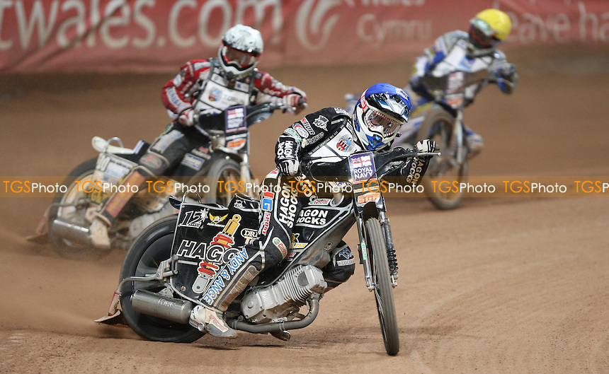 Semi-Final 1: Chris Holder (blue), Hans Andersen (white) and Rune Holte (yellow) - British Speedway Grand Prix at the Millennium Stadium, Cardiff - 10/07/10 - MANDATORY CREDIT: Rob Newell/TGSPHOTO - Self billing applies where appropriate - 0845 094 6026 - contact@tgsphoto.co.uk - NO UNPAID USE.