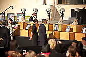 Fort Hood, TX - November 10, 2009 -- United States President Barack Obama and Michelle Obama pay tribute to fallen soldiers, who died in the shooting spree last Thursday, at a Memorial Service held at Fort Hood, Texas on Tuesday, November 10, 2009..Credit: Erin Trieb / Pool via CNP
