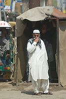 A Pakistani man standing on the street in Islamabad