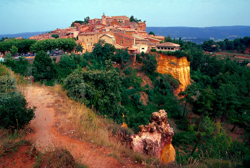 Precarious view of the old French village of Rousillon, built on the edge ochre cliffs. France.