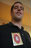 16 December 2006: Stanford Cardinal athletic trainer Eitan Gelber shows off his personal frame pin of injured player Alex Fisher during Stanford's 2006 NCAA Division I Women's Volleyball Final Four at the Embassy Suites in Omaha, NE.