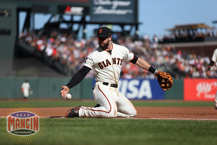 SAN FRANCISCO, CA - AUGUST 11:  Evan Longoria #10 of the San Francisco Giants tries to make a play at third base against the Philadelphia Phillies during the game at Oracle Park on Sunday, August 11, 2019 in San Francisco, California. (Photo by Brad Mangin)