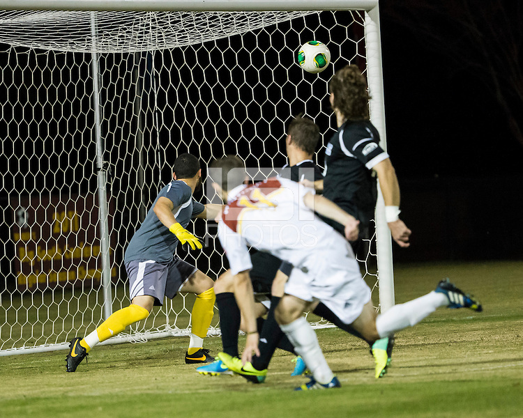 The Winthrop University Eagles beat the UNC Asheville Bulldogs 4-0 to clinch a spot in the Big South Championship tournament.  Asheville goalkeeper Zak Davis (23) watches the ball go into the goal after a shot by Winthrop's Patrick Barnes (11)