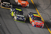 Feb 9, 2008; Daytona, FL, USA; Nascar Sprint Cup Series driver Jimmie Johnson (48) races alongside teammate Jeff Gordon (24) during the Bud Shootout at Daytona International Speedway. Mandatory Credit: Mark J. Rebilas-US PRESSWIRE