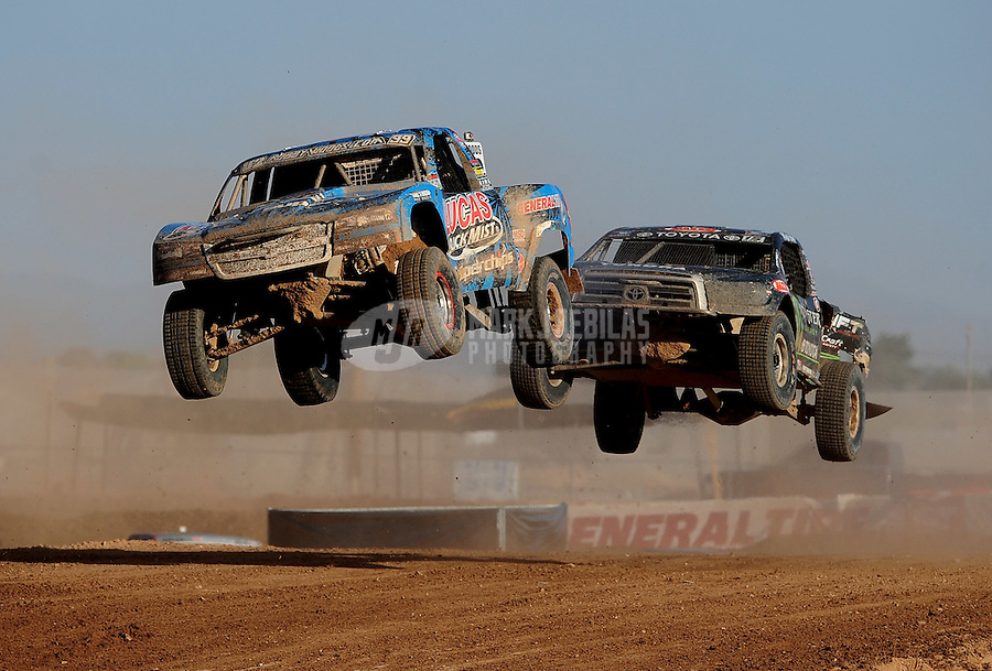 Apr 17, 2011; Surprise, AZ USA; LOORRS driver Robby Woods (99) leads Marty Hart (15) during round 4 at Speedworld Off Road Park. Mandatory Credit: Mark J. Rebilas-