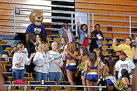 11 November 2011:  FIU's Golden Dazzlers give out banners to fans during a break in the action as the FIU Golden Panthers defeated the Jacksonville University Dolphins, 63-37, at the U.S. Century Bank Arena in Miami, Florida.