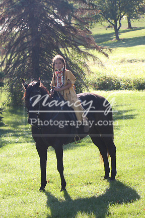 Native American Indian Lakota Sioux boy riding a black horse