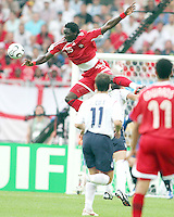 Kenwyne Jones of Trinidad soars over John Terry of England. England defeated Trinidad & Tobago 2-0 in their FIFA World Cup group B match at Franken-Stadion, Nuremberg, Germany, June 15 2006.