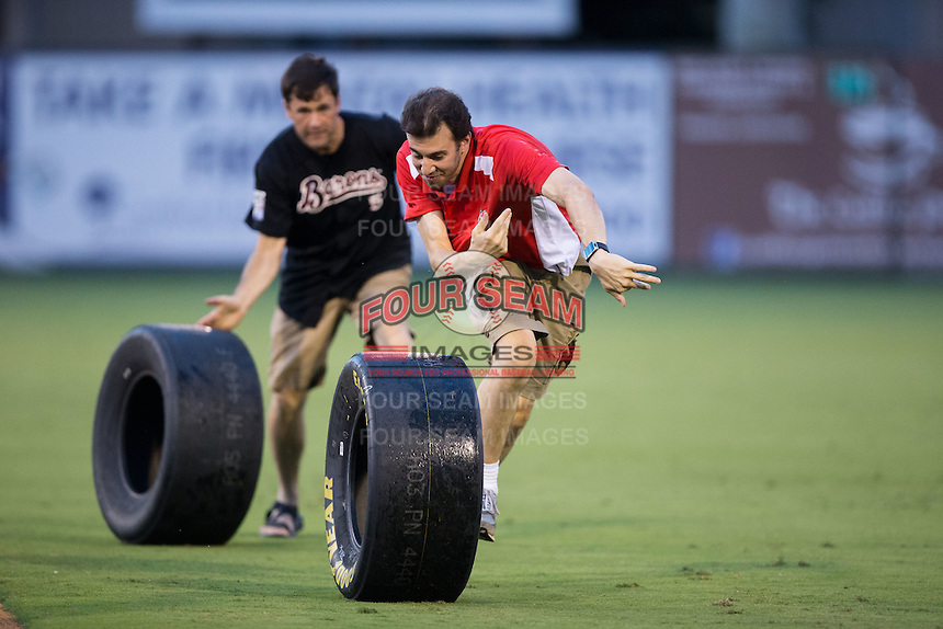 Two fans compete in the tire race between innings of the South Atlantic League game between the West Virginia Power and the Kannapolis Intimidators at Kannapolis Intimidators Stadium on August 20, 2016 in Kannapolis, North Carolina.  The Intimidators defeated the Power 4-0.  (Brian Westerholt/Four Seam Images)