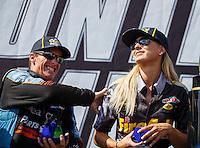 Sep 18, 2016; Concord, NC, USA; NHRA top fuel driver Leah Pritchett (right) and Clay Millican during the Carolina Nationals at zMax Dragway. Mandatory Credit: Mark J. Rebilas-USA TODAY Sports