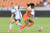 Houston, TX - Saturday July 08, 2017: Emily Sonnett and Nichelle Prince battle for control during a regular season National Women's Soccer League (NWSL) match between the Houston Dash and the Portland Thorns FC at BBVA Compass Stadium.