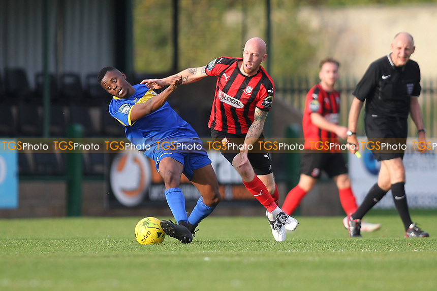 Khadean Campbell of Romford and Darren Mills of Coggeshall during Romford vs Coggeshall Town, Bostik League Division 1 North Football at Rookery Hill on 13th October 2018