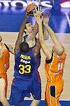 Baloncesto Fuelabrada's Lubos Barton (r) and FC Barcelona Regal's Pete Mickeal (l) and Fran Vazquez (c) during Liga Endesa ACB match.October 30,2011. (ALTERPHOTOS/Acero)