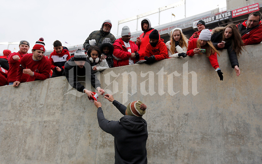 Wide receiver Michael Thomas hands back an autograph during the Ohio State football National Championship celebration at Ohio Stadium on Saturday, January 24, 2015. (Columbus Dispatch photo by Jonathan Quilter)