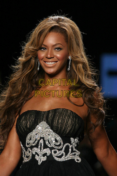 BEYONCE KNOWLES.Modelling at  Fashion For Relief Show at Olympus Fashion Week held at Bryant Park,.New York City, 16th September 2005.portrait headshot black strapless chiffon dress catwalk model.Ref: IW.www.capitalpictures.com.sales@capitalpictures.com.©Capital Pictures