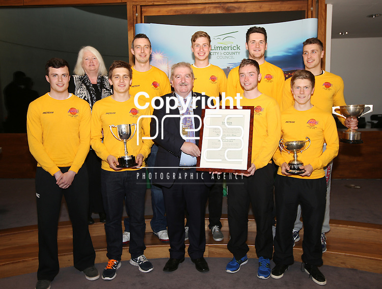 With compliments.  A Civic Reception on Wednesday evening last in the Council Chamber, Dooradoyle to honour the following  : The Irish Red Cross Limerick Area celebrating seventy five years of volunteer service to the people of Limerick City and County. The Under 20's Team 2014/2015 The Limerick Lakers Basketball Club in recognition of the Club winning The Cork County Cup, The Cork League Cup and The Cork League Top Four Playoff Cup and The Crescent College Comprehensive Senior Girls Hockey Squad in recognition of the Squad winning The All Ireland Kate Russell Hockey Tournament 2015.  Photographed at the event were the Lakers Basketball squad including team manager Chris Reidy receiving the parchment from the Mayor of Limerick Cllr Kevin Sheahan.       Photograph Liam Burke/Press 22